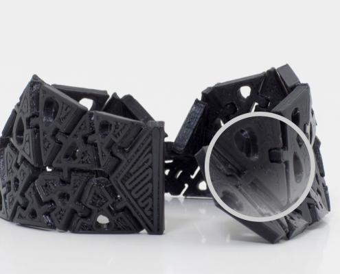 Immagine del dettaglio di un braccialetto mobile realizzato in un pezzo solo con la stampante 3D Kentstrapper Verve